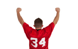 stock-photo-18789316-sports-fan-standing-with-his-arms-raised
